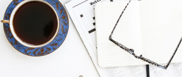 Coffee, crossword and galsses on a table