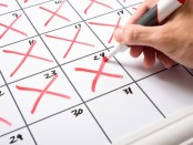 Calendar being crossed of with red crosses