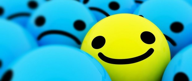 An image of a bunch of smiley being blue and sad, with one yellow happy one mixed in.